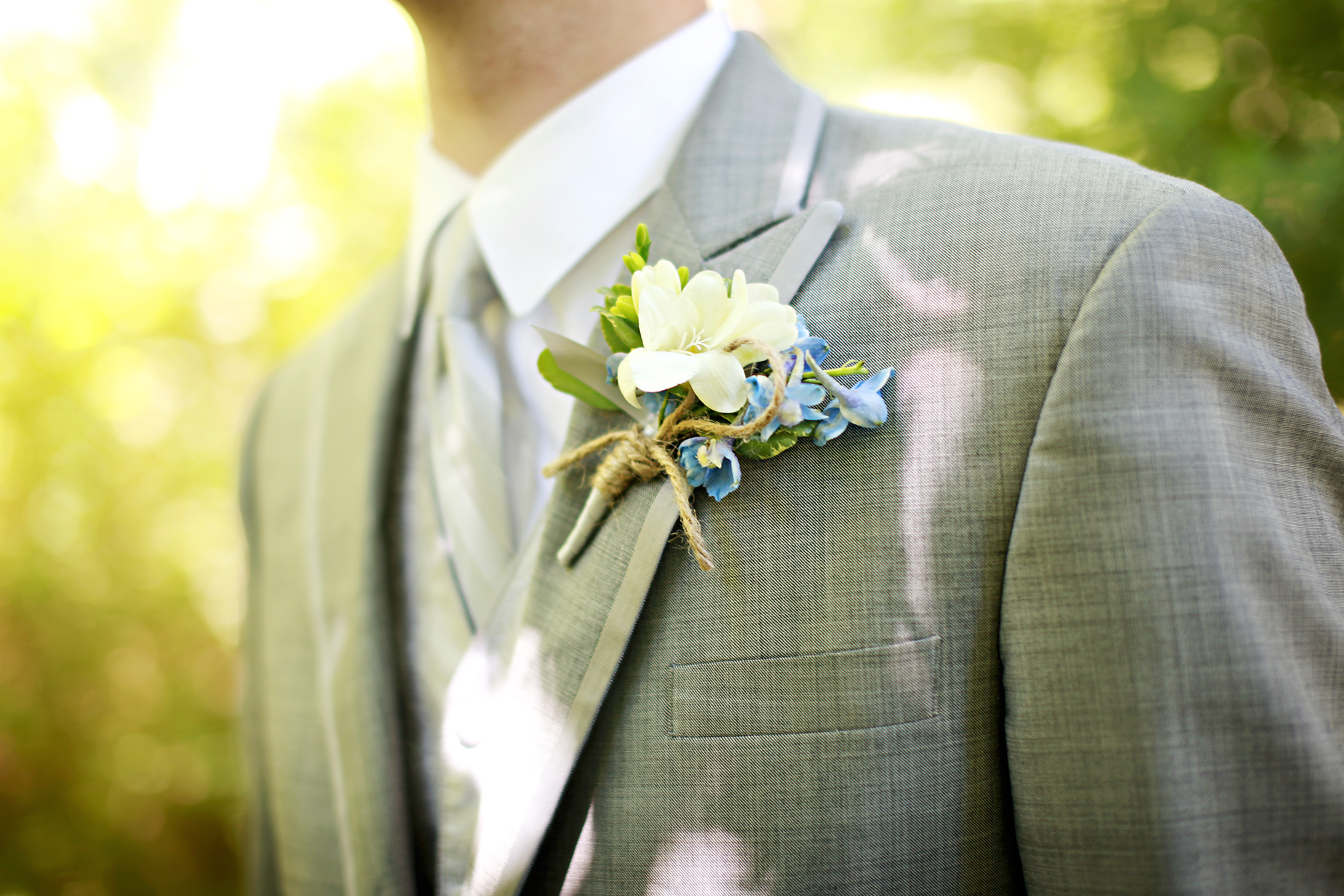White freesia with blue delphinium wrapped with silver satin ribbon ... Blue Hydrangea Boutonniere
