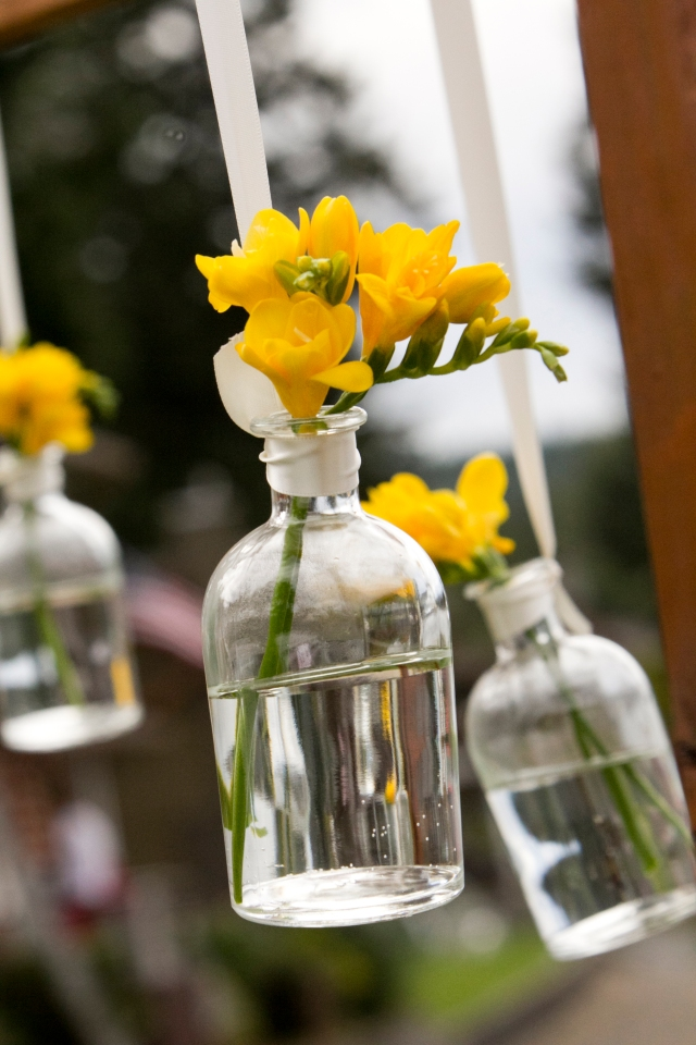 Hanging Bottles of Freesia