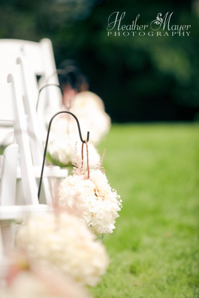Hanging mason jars of hydrangea, dahlias, baby's breath & astilbe  by Jen's Blossoms | photo by Heather Mayer Photography