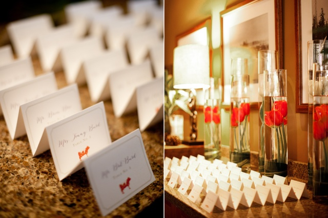 Cylinders of Tulips for the Escort Card Display | © Kimberly Kay Photography