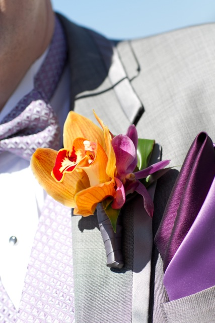 Orangey Bronze Orchid Boutonniere || Flowers by Jen's Blossoms || Photo by: Tasha Owen Photography